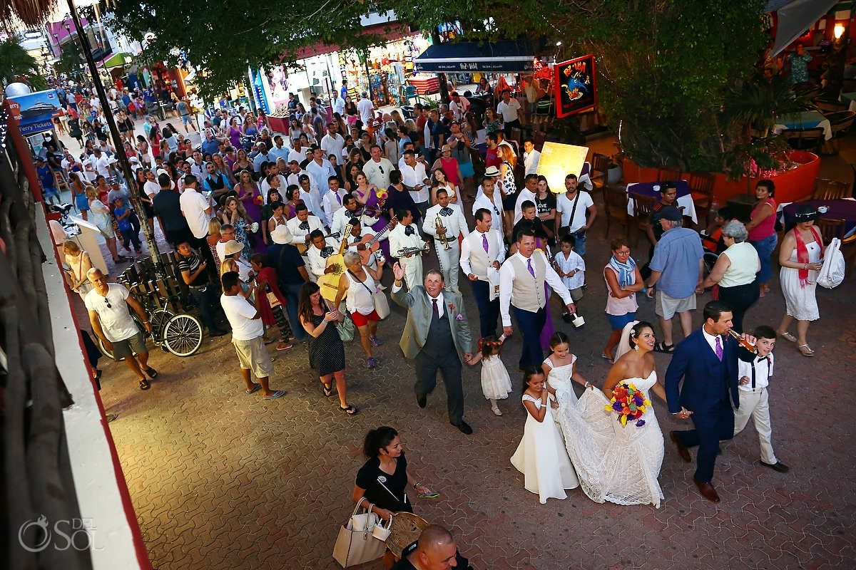 bride groom wedding guests walking playa del Carmen 5th avenue going to reception Mamita's beach club