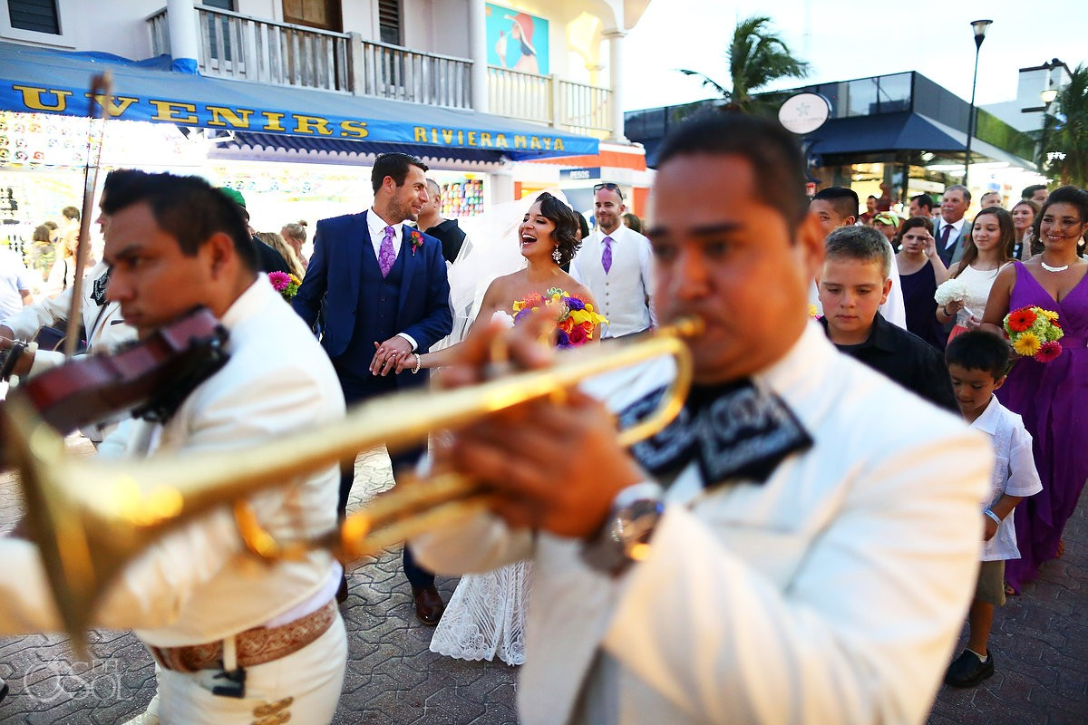 Bride and Groom walking next to mariachis after ceremony Nuestra Señora del Carmen, Playa del Carmen, Mexico