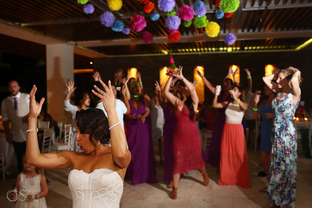 Bride throwing bouquet during reception Mamita's beach club Playa del Carmen