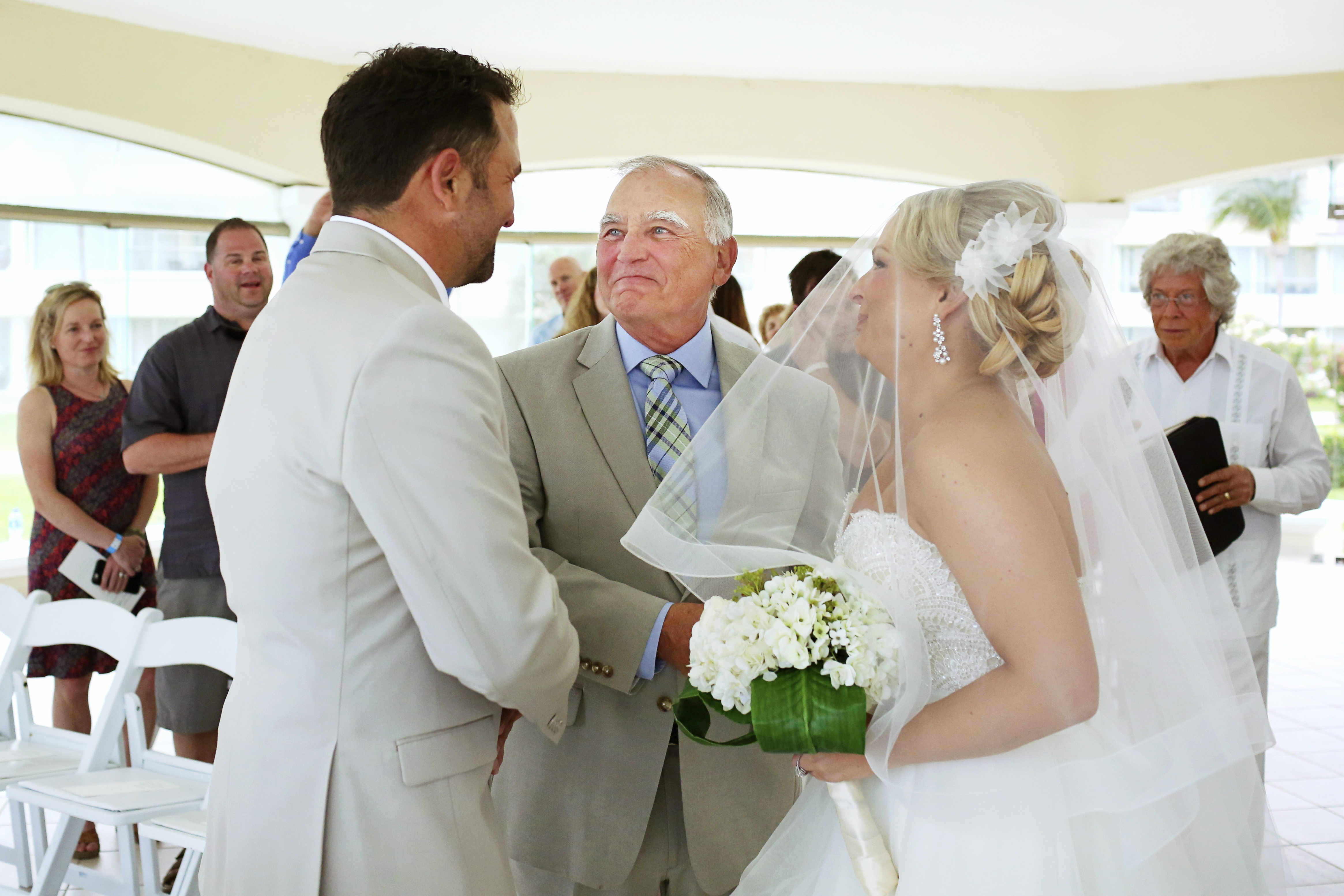 Father giving the bride away wedding ceremony Moon Palace Playa del Carmen Mexico