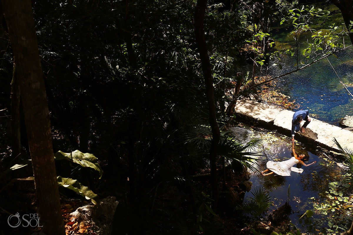 Bride swimming Cenote Trash the Dress Riviera Maya Mexico
