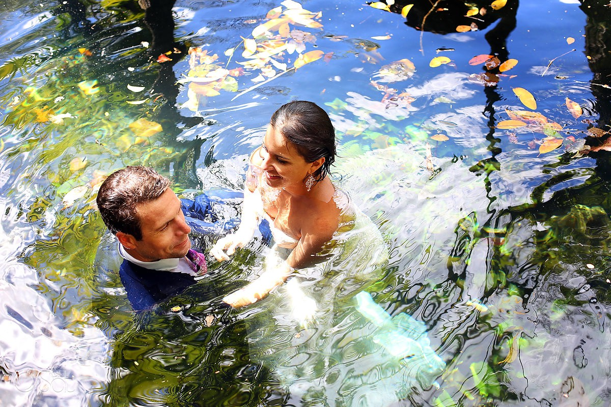 Bride and Groom swimming Cenote Trash the Dress Riviera Maya Mexico