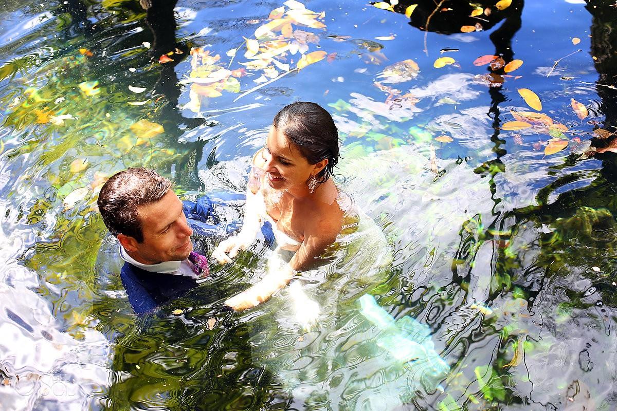 Bride and Groom swimming Cenote Trash the Dress Riviera Maya Mexico
