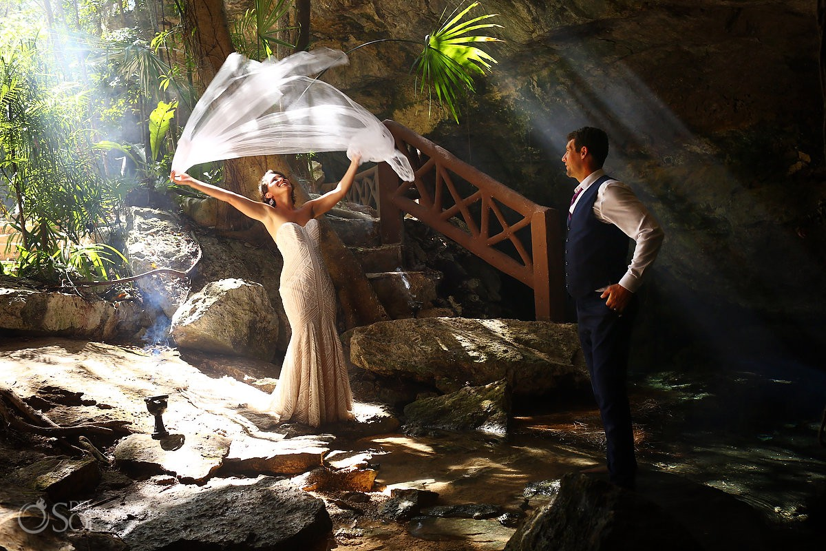 bride playing veil beautiful light Cenote Trash the Dress Riviera Maya Mexico