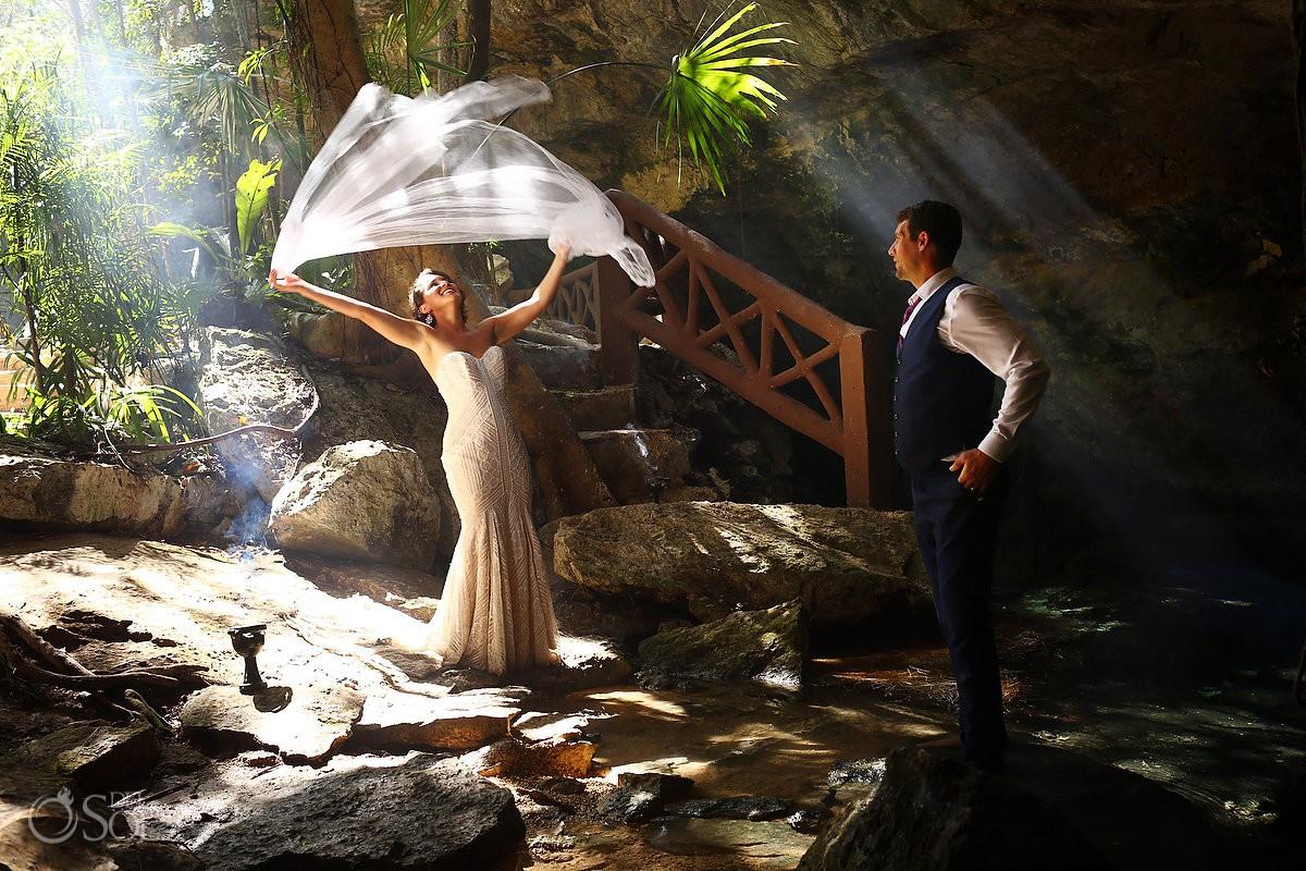 bride playing veil beautiful light Cenote Trash the Dress Riviera Maya Mexico