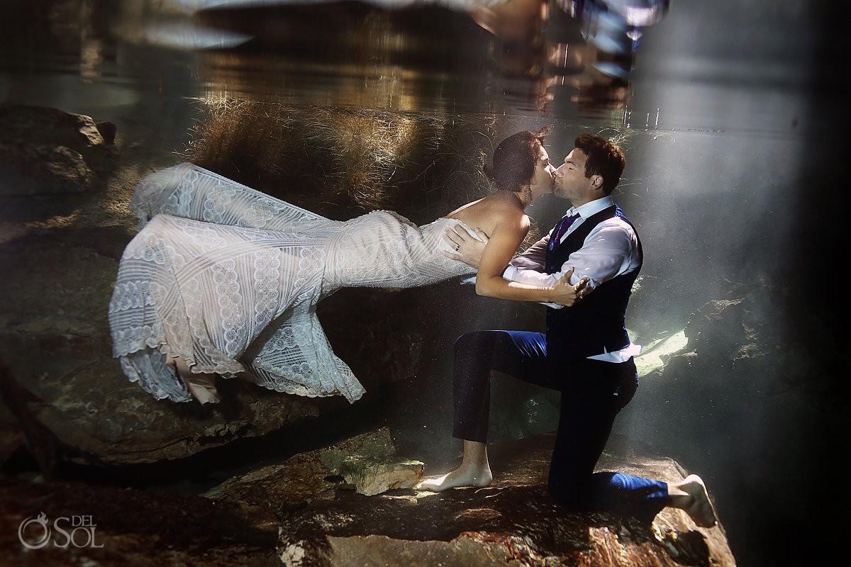 Underwater trash the dress bride and groom kiss Cenote Trash the Dress Riviera Maya Mexico