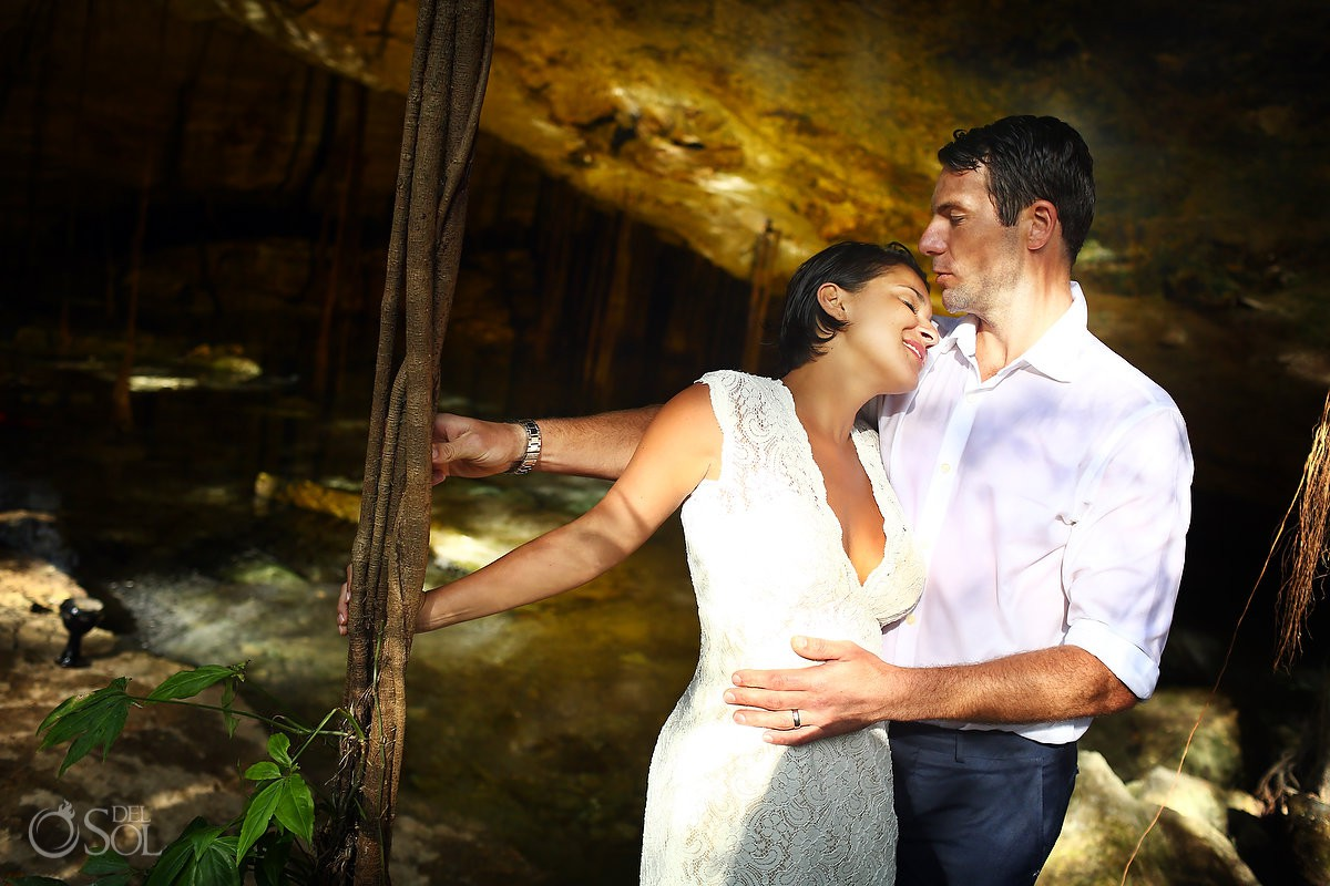 Romantic bride and groom portrait amazing sun light Cenote Trash the Dress Riviera Maya Mexico