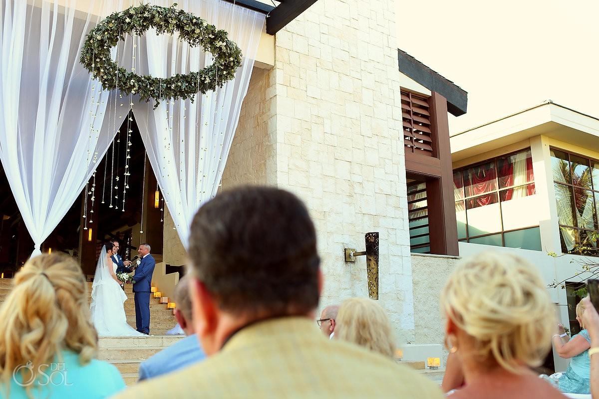 Dreams Riviera Cancun Grand Staircase destination wedding ceremony flower chandelier romantic decor