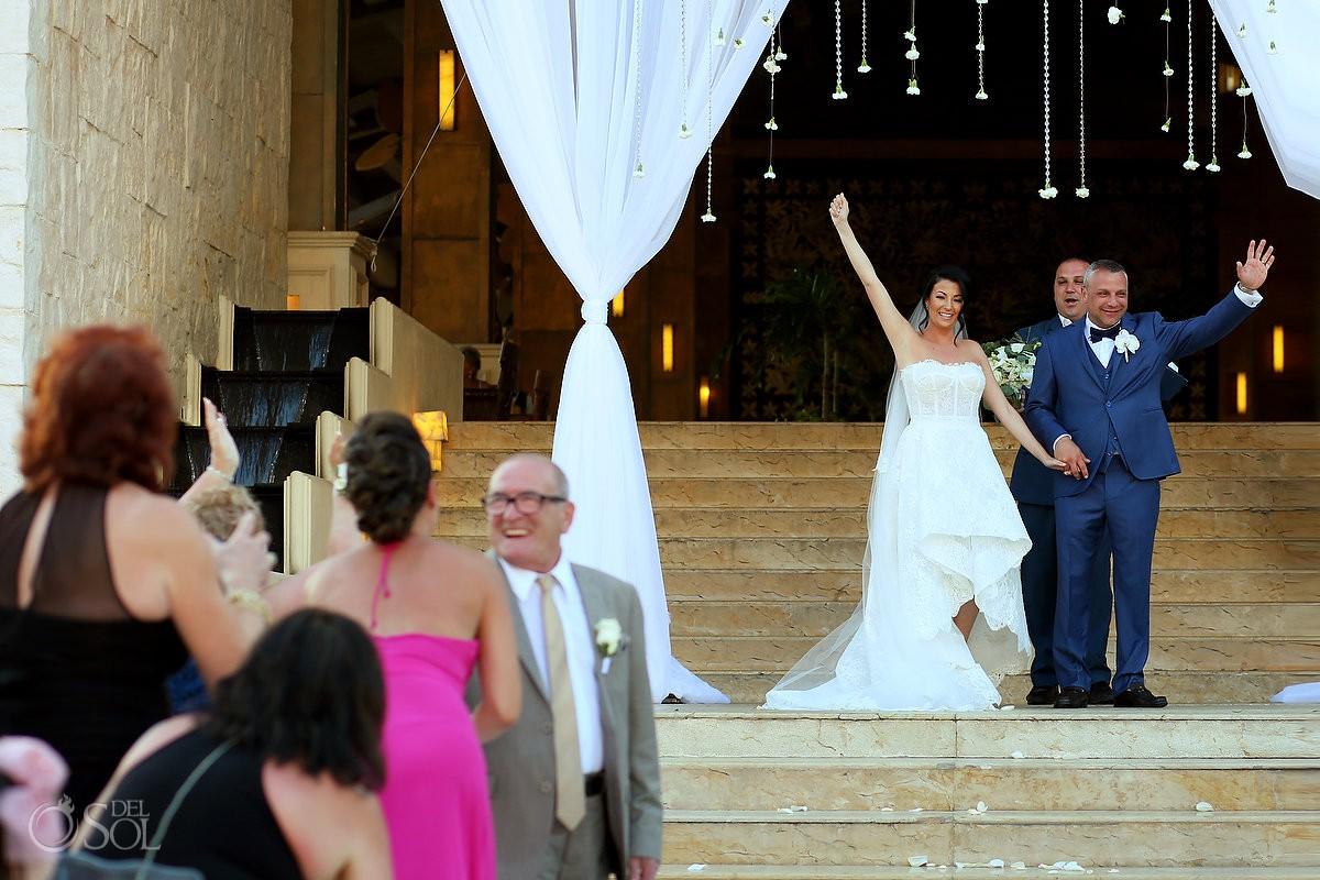 Dreams Riviera Cancun Grand Staircase destination wedding celebration after ceremony