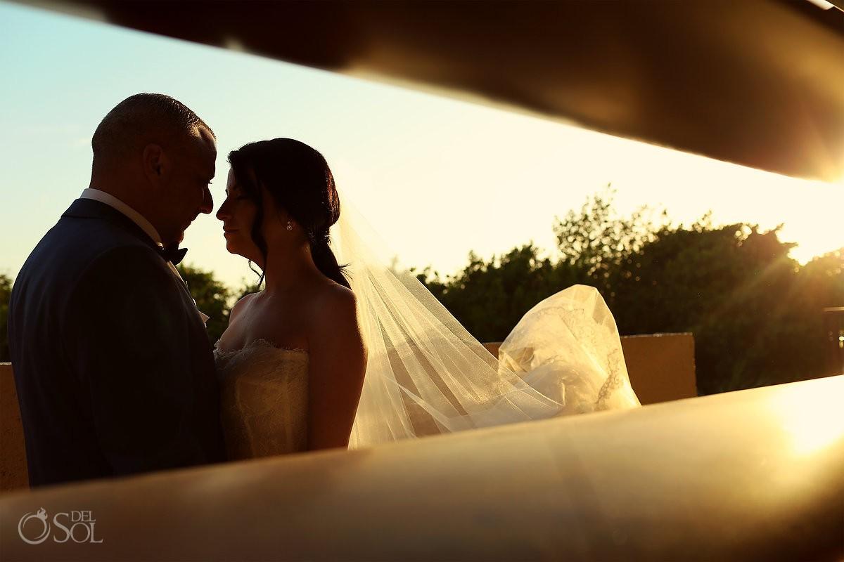 Destination Wedding bride groom sunlight flare portrait Dreams Riviera Cancun Resort Mexico