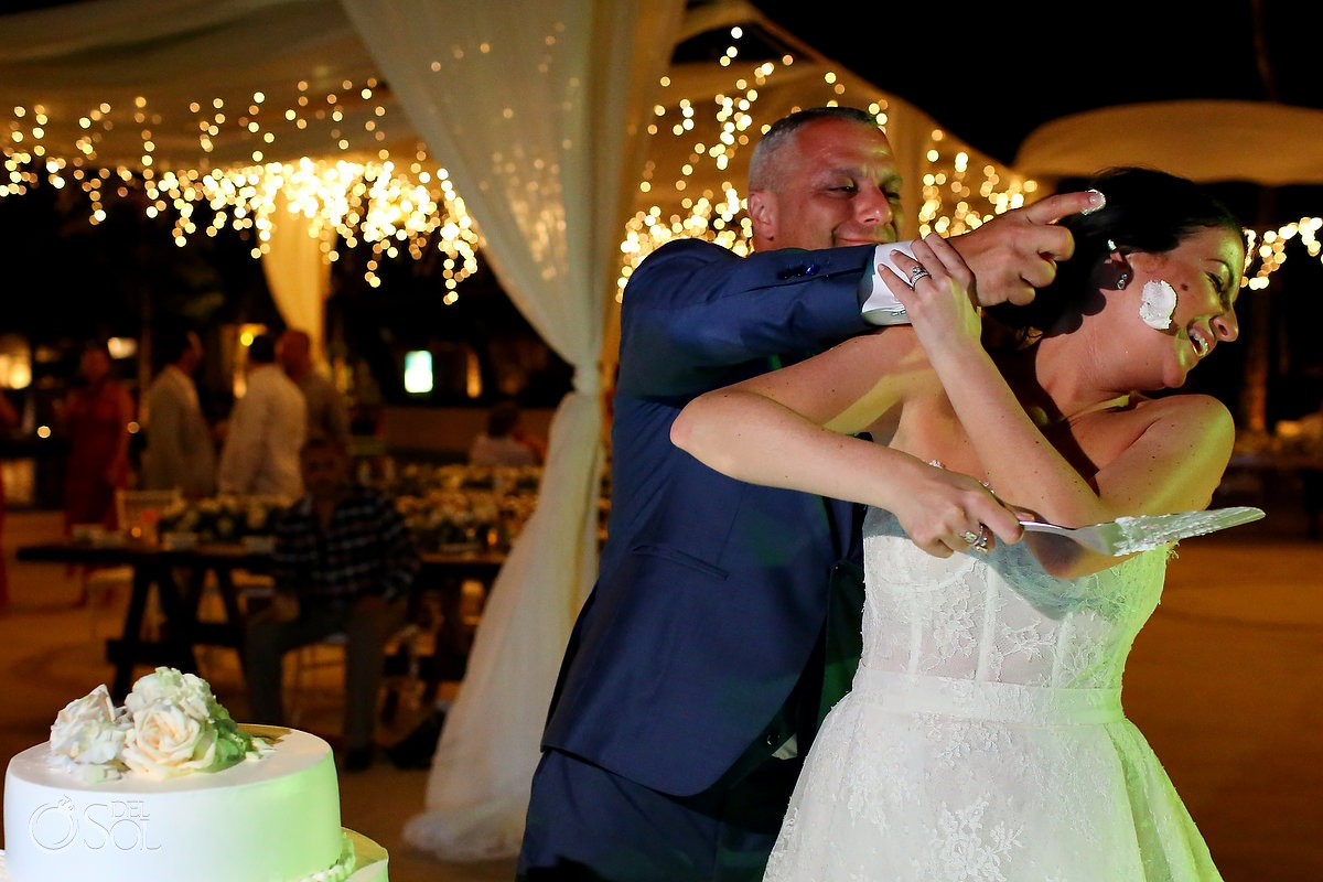 Destination Wedding funny cake cutting Dreams Riviera Cancun Resort Mexico