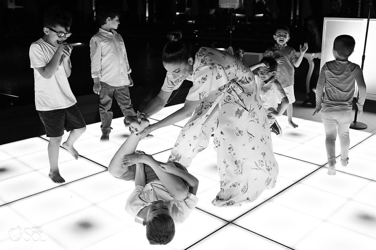 Destination Wedding kids having fun dance floor Dreams Riviera Cancun Resort Mexico