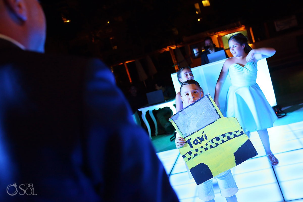 Destination Wedding funny kids taxi playing Dreams Riviera Cancun Resort Mexico
