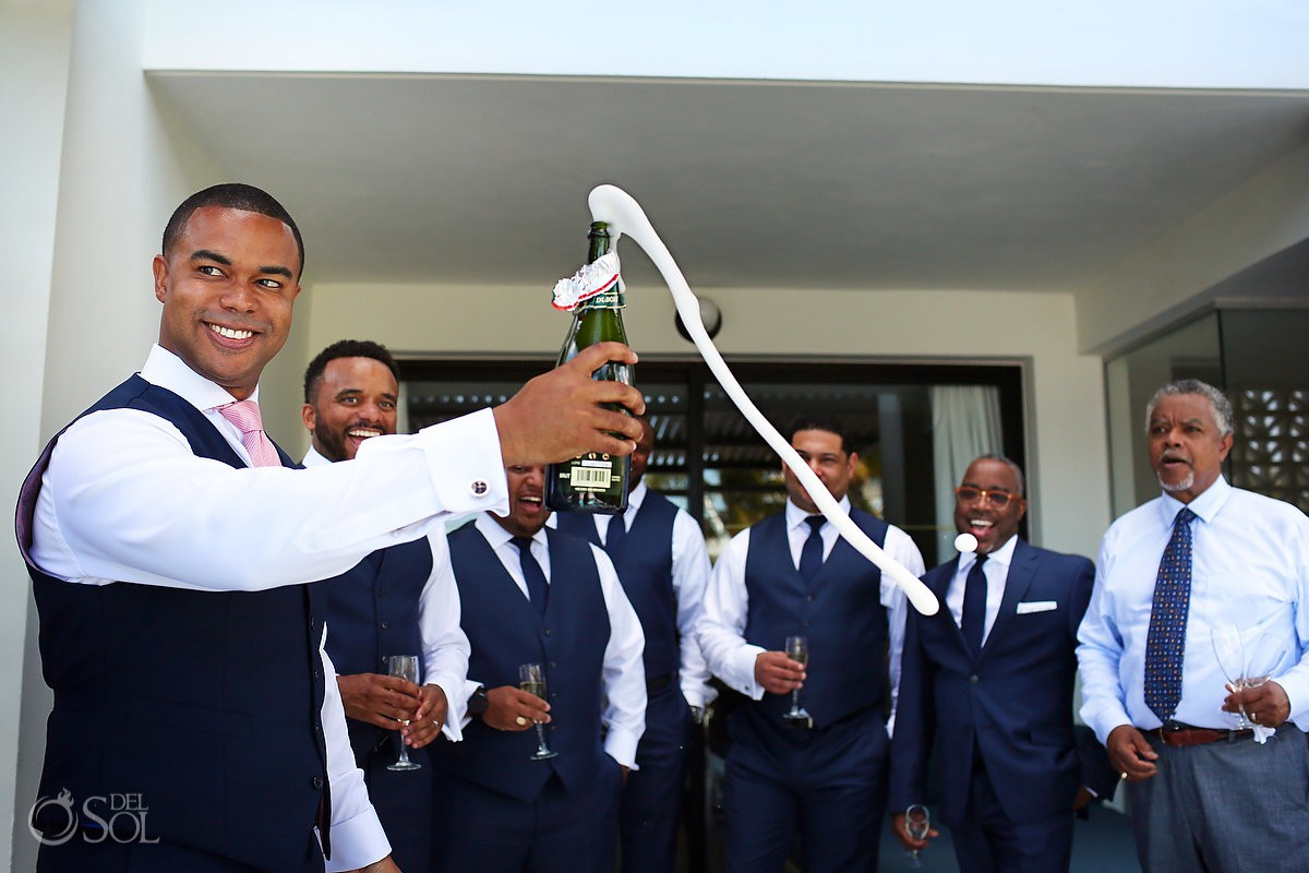 Groom and groomsman toast Finest Resort Playa Mujeres Cancun Mexico