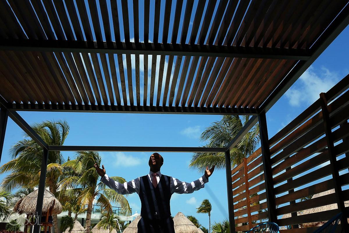 Creative groom portrait destination wedding Finest Resort Playa Mujeres Cancun Mexico.