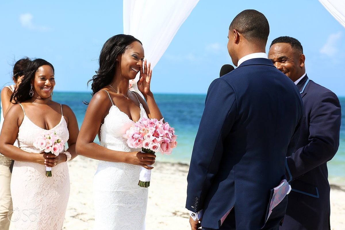 Bride crying in vows destination wedding ceremony Finest Resort Playa Mujeres Cancun Mexico