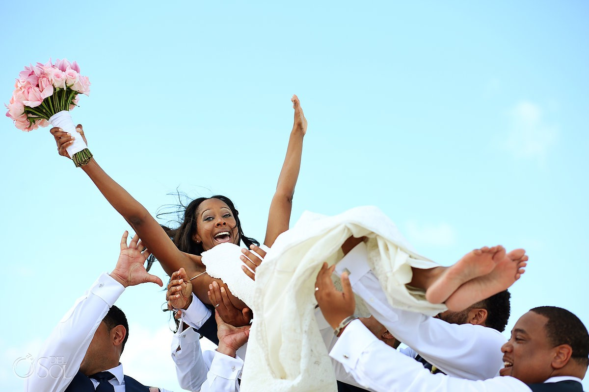 bride and groomsman having fun Finest Resort Playa Mujeres Cancun Mexico