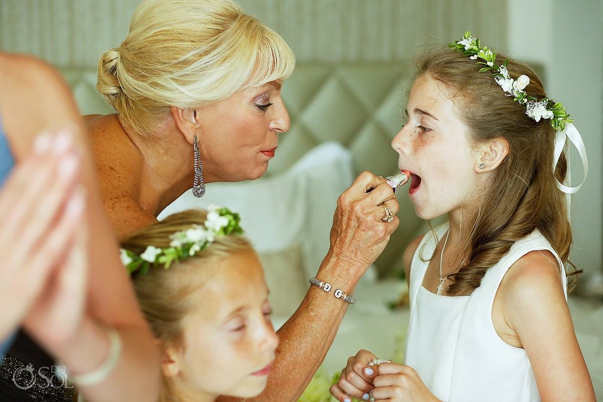 Flower girl getting ready before wedding ceremony Moon Palace Playa del Carmen Mexico