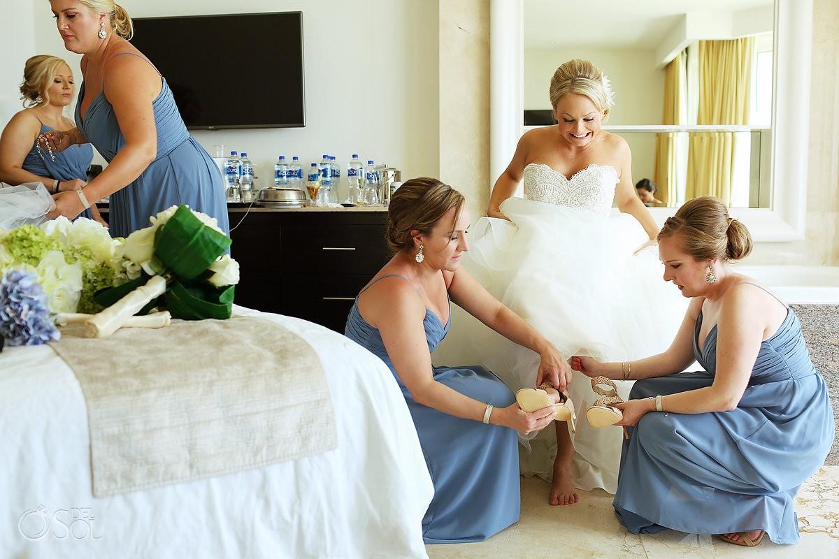 Bridesmaids getting helping bride getting ready Moon Palace Playa del Carmen Mexico