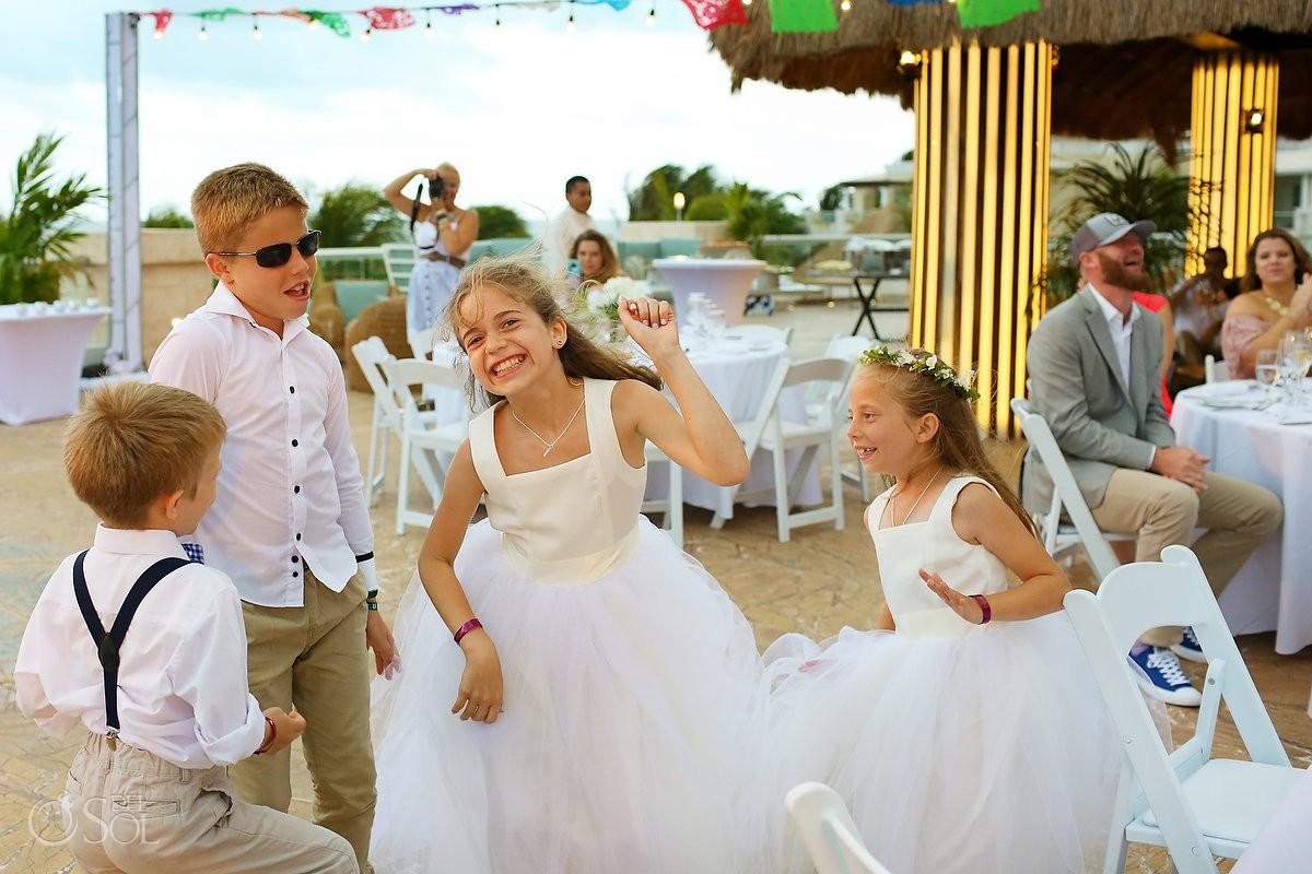 kids having fun wedding reception Moon Palace Mexico