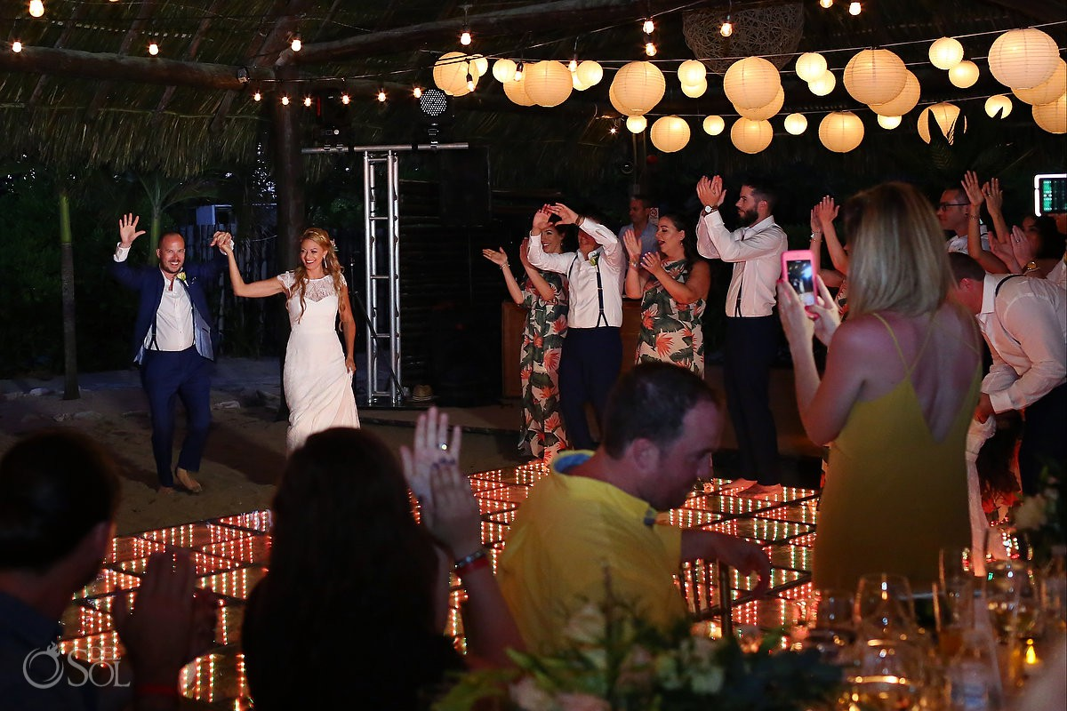 Bride and groom entrance wedding reception Blue Venado Beach Club Playa del Carmen Mexico