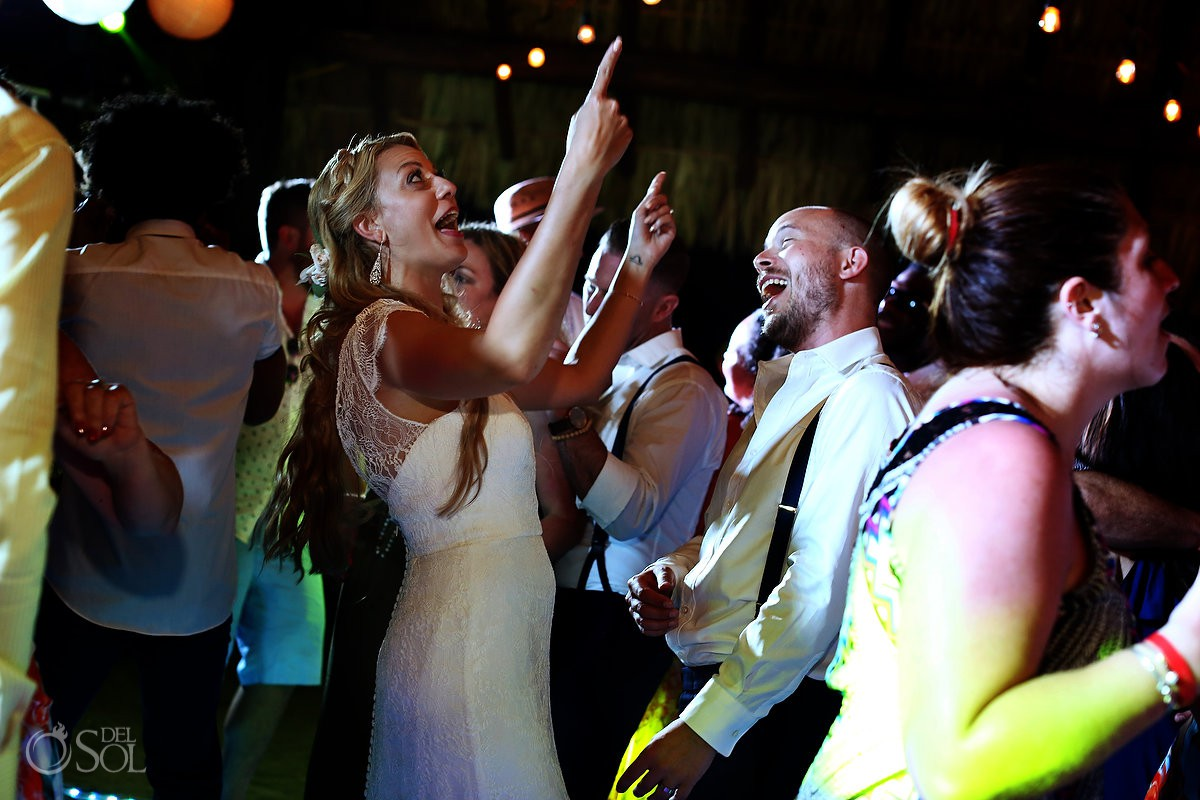 Bride and groom having fun wedding reception Blue Venado Beach Club Playa del Carmen Mexico