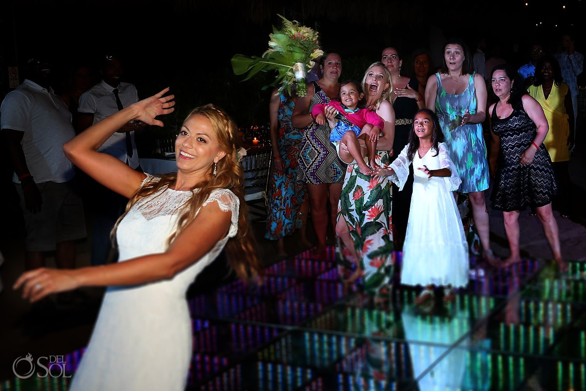 Bride throwing bouquet destination wedding Blue Venado Beach Club Playa del Carmen Mexico.