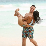 Matching bathing suits Couple having fun at beach engagement photography Tulum México