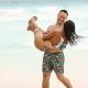 Matching bathing suits Couple having fun at beach engagement photography Tulum México