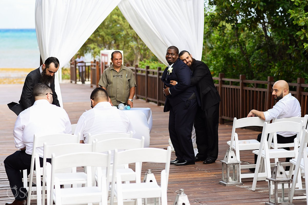 best man giving love groom before wedding ceremony Paradisus La Esmeralda Playa Del Carmen Playa del Carmen