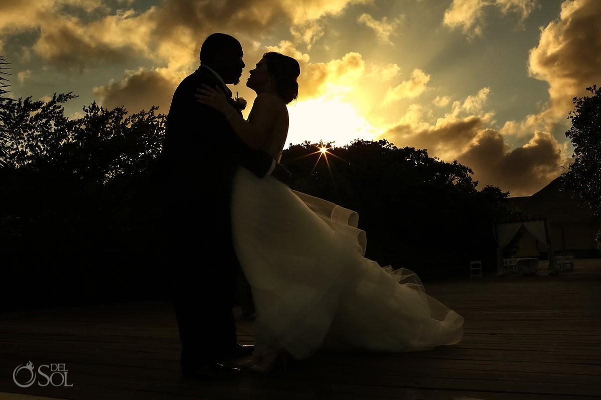 Bride and groom beach sunset portrait silhouette Destination Wedding Paradisus La Esmeralda Playa Del Carmen