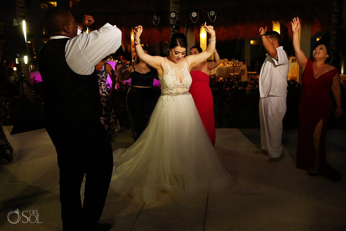 Bride dancing having fun wedding reception Paradisus La Esmeralda Playa Del Carmen