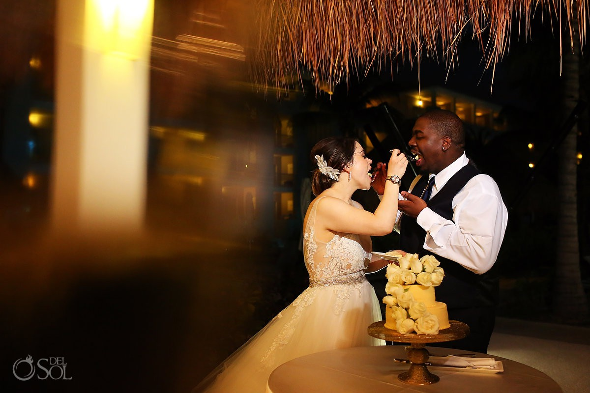 Bride and groom cake cutting Destination Wedding Paradisus La Esmeralda Playa Del Carmen