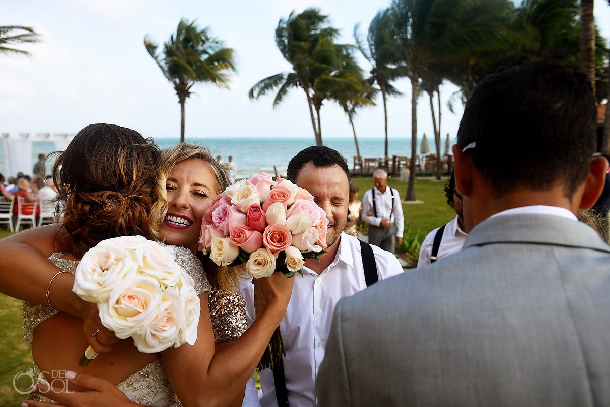 Fun hugs wedding ceremony Secrets Capri Riviera Cancun Playa del Carmen Mexico
