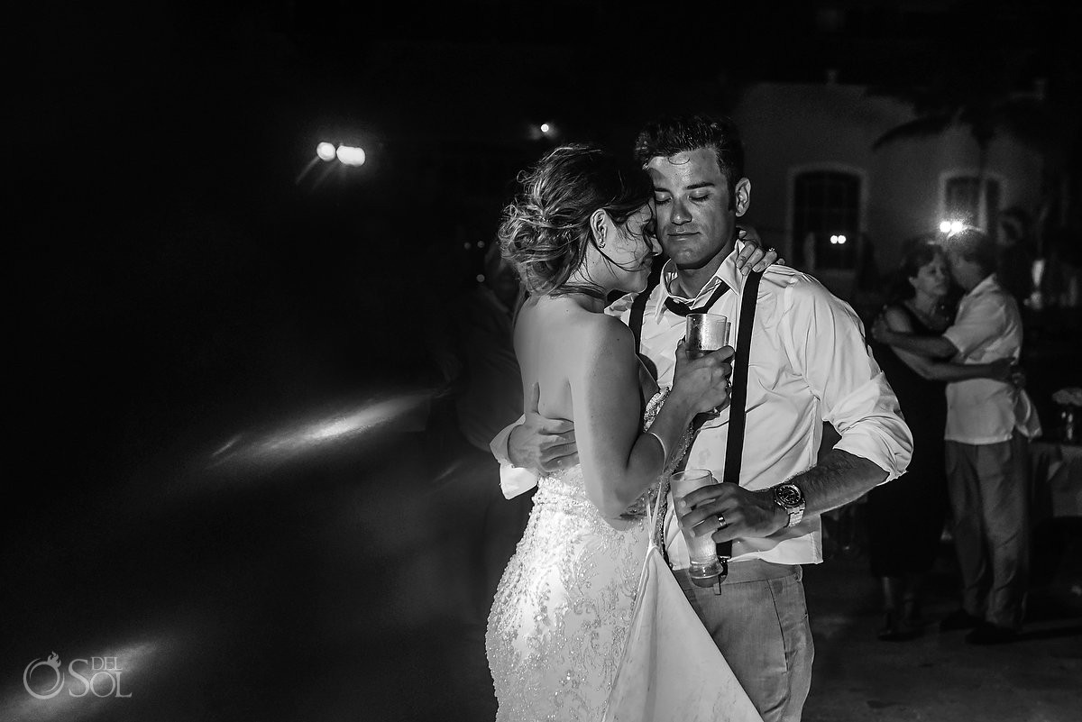 Emotional bride and groom hug Secrets Capri Riviera Cancun Playa del Carmen Mexico