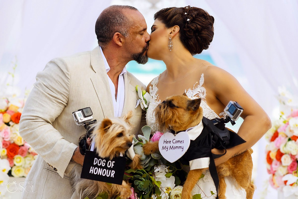 Bride and groom first kiss beach wedding Casa Corazon Playa del Carmen, Mexico.
