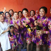 Bride and bridesmaids funny opening champagne Wedding Hard Rock Hotel Riviera Maya Mexico