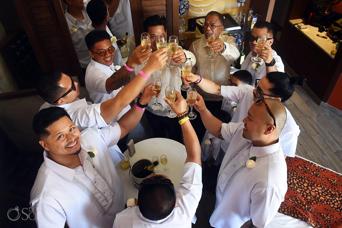 Groom and groomsman toasting getting ready Wedding Hard Rock Hotel Riviera Maya Mexico