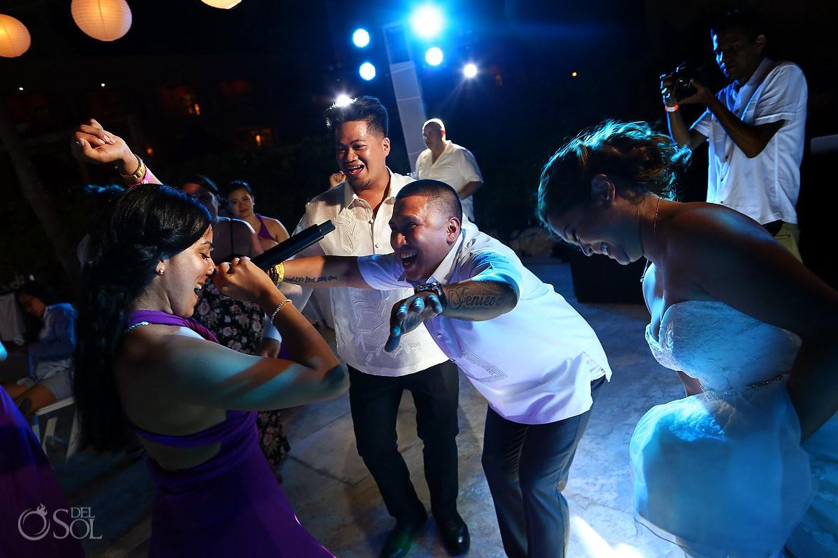 Bridesmaid singing bride and groom wedding reception party Hard Rock Hotel Riviera Maya Mexico