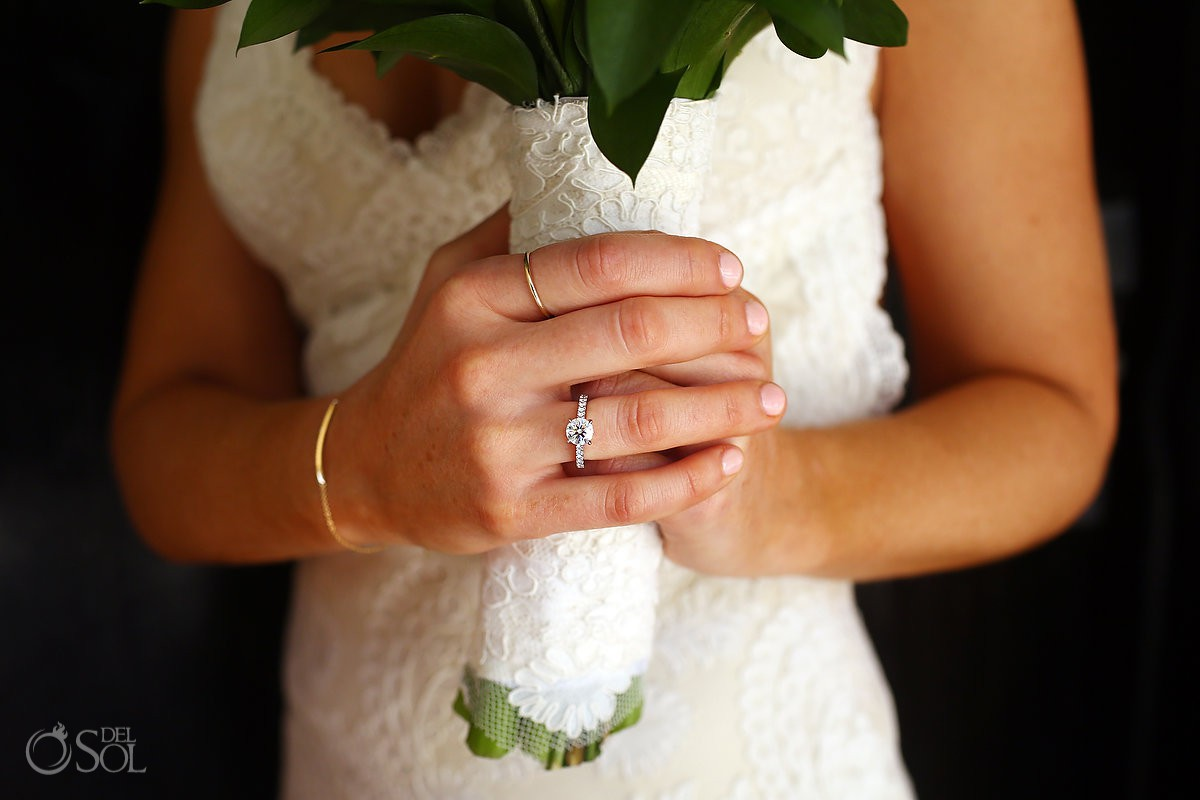 wedding detail photograph pride holding bouquet with lace cover and diamond engagement ring