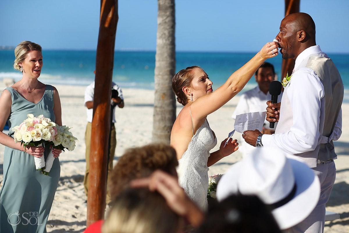 Bride cleaning grooms tears Destination wedding Secrets Maroma Beach Riviera Cancun