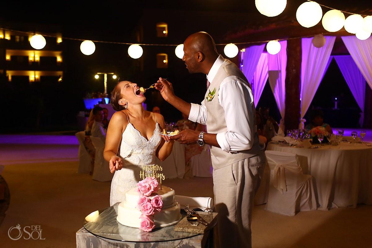 Bride and groom cutting cake Secrets Maroma Beach Riviera Cancun