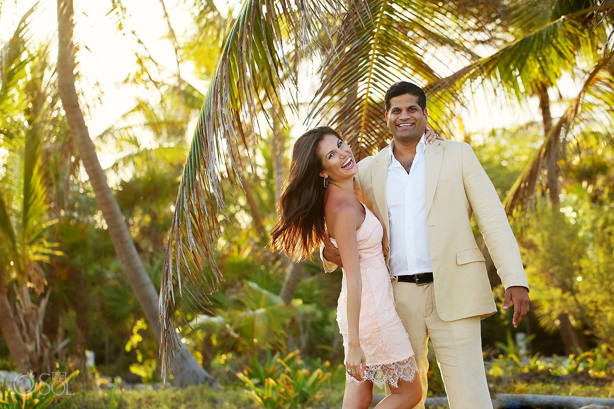 couple laughing palm tree background Riviera Maya Save the Date Engagement Session