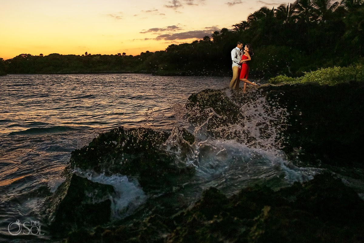 waves splashing on rocks sunset Grand Sirenis Riviera Maya save the date engagement session