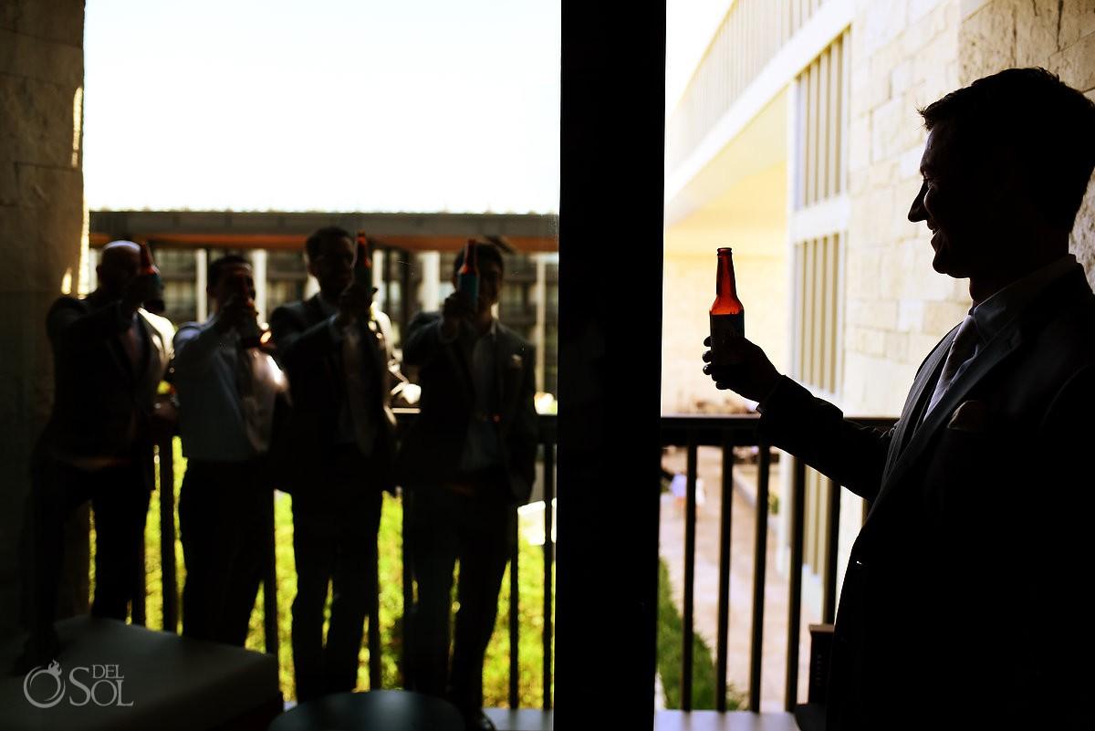 Groom drinking beer with groomsmen getting ready Grand Hyatt Playa del Carmen Mexico