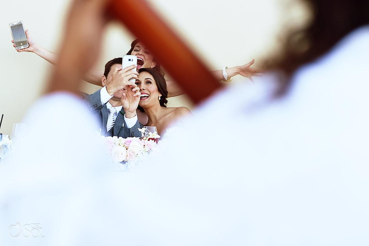 bride and groom taking selfie destination wedding reception Grand Hyatt Playa del Carmen Mexico