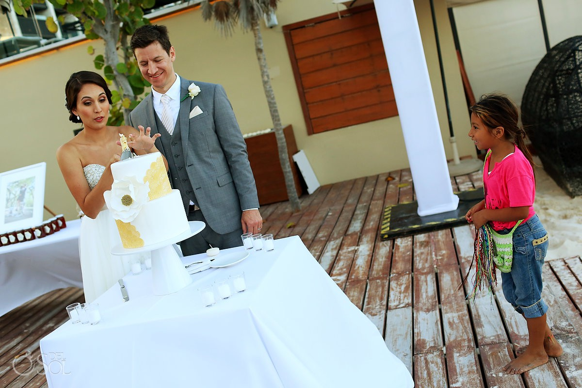 cutting the wedding cake destination wedding reception Grand Hyatt Playa del Carmen Mexico