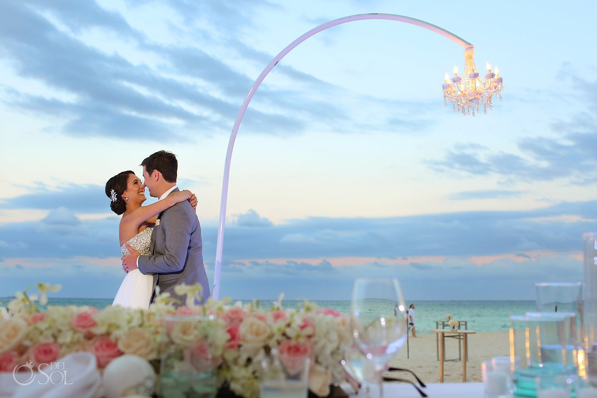 first dance with chandelier decoration and pink and cream rose centerpieces destination wedding reception Grand Hyatt Playa del Carmen Mexico