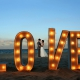 giant love sign wedding portrait destination wedding reception Grand Hyatt Playa del Carmen Mexico