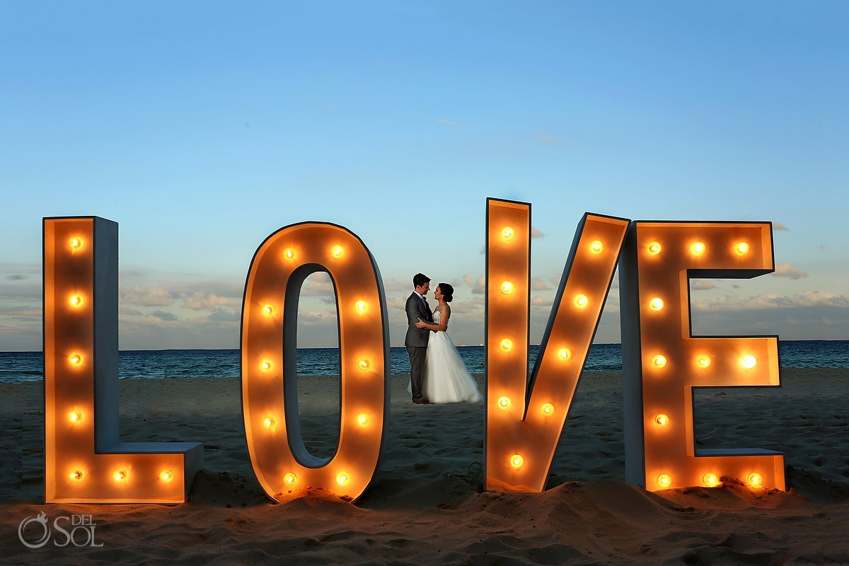 giant love sign wedding portrait destination wedding reception Grand Hyatt Playa del Carmen Mexico
